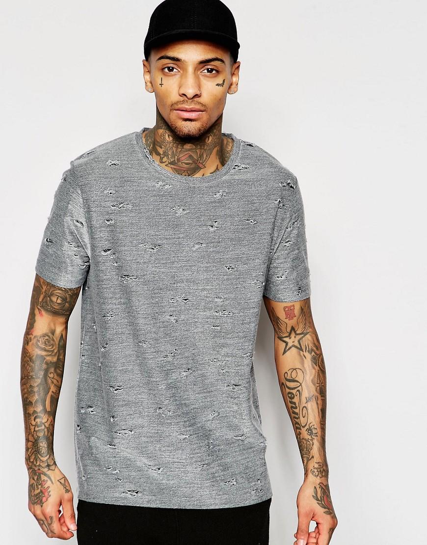 Camiseta holgada con detalles desgastados de ASOS
